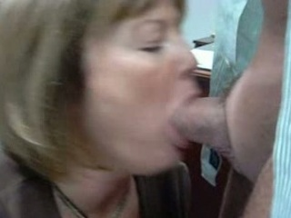lady momor lady is giving a bj to the boss at the