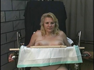 candy obtains restrained on a chair with leather