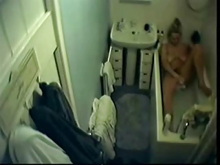 my beautiful woman plays  inside shower tube.