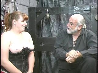 amateur bdsm slave girl brunette in corset is