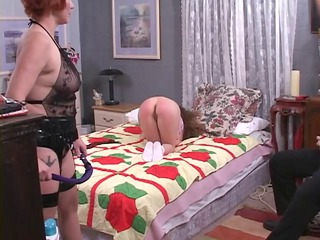 beautiful lesbian dominatrix spanks the hell out
