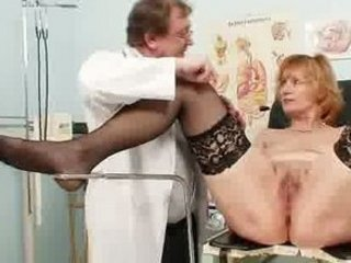 redhaired elderly horny kitty stretching inside