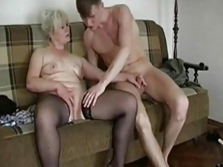 plump blond old seduces a y...