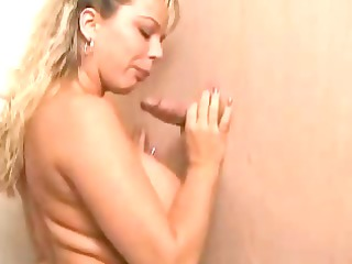 busty blonde sucks a libido through the gloryhole