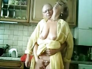 se mum and dad having joy inside the kitchen.